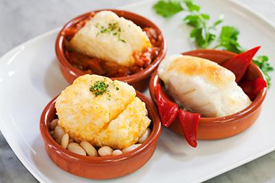 Bacallà a les tres maneres (llauna, samfaina i mussolina d'alls) Restaurant La Conca.