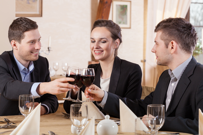 Friends drinking wine in a restaurant