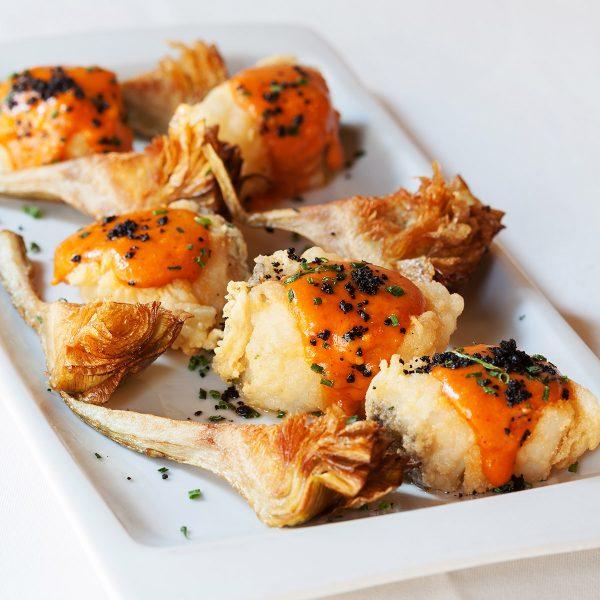 Carxofes del Prat amb morro de bacallà i romesco d'avellanes. Petit Firo.